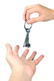 Hands exchange keys isolated Royalty Free Stock Photos