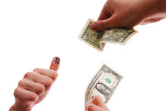 Hands exchanging dollars Stock Image