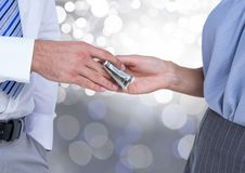 Hands exchanging money business with sparkling light bokeh background. Digital composite of Hands exchanging money business with sparkling light bokeh background royalty free stock photos