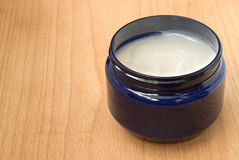 Hands and face cream in blue pot Royalty Free Stock Photos