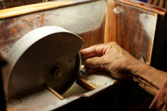 Hands during faceting of gemstone. Stock Photos