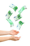 Hands and falling money. Isolated on white background Royalty Free Stock Photography