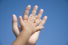 Hands family. On a blue sky background