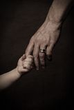 Hands of father and child. Stock Image