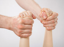 Hands of a father holding a child and swinging him (her) Royalty Free Stock Photo