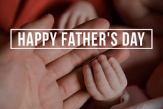 Hands of father and of newborn baby. Fathers day. Stock Photo