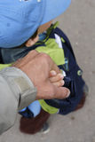 The hands of the father and of the son. The father's hand holding his son's hand Royalty Free Stock Images
