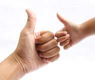 Hands of the father and son giving like. On white Royalty Free Stock Images