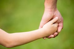 Hands of father and son Stock Photos