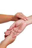 Hands feeling pulse at wrist Royalty Free Stock Photography