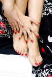 Hands and feet. Beautiful woman hands and feet with red nails stock images