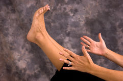 Hands and feet in yoga boat pose asana Royalty Free Stock Photos