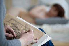 Hands of female artist draws sketch in front of nude model in drawing class Royalty Free Stock Photos