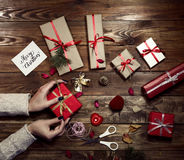Hands of female carefully preparing many gifts Stock Photos