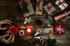 Hands of female carefully preparing many gifts Royalty Free Stock Photos