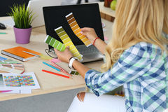 Hands of female designer in office working with colour samples Royalty Free Stock Photo