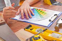 Hands of female disigner on table with construction tools Royalty Free Stock Photography