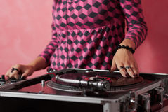 Hands of female DJ mixing music Stock Images
