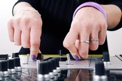 Hands of female DJ playing Royalty Free Stock Image