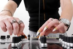 Hands of female DJ playing Royalty Free Stock Photo