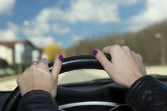 Hands of female driver on steering wheel Royalty Free Stock Photo