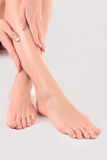 Hands on female feet Stock Photography
