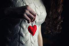 Hands female heart breast. Object red heart-shaped hands holding a young person royalty free stock images