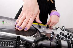 Hands of female hip-hop DJ scratching. Girl mixing two records on turntables. Top-class equipment for a hip-hop disc jockey Stock Images