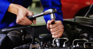 Hands of female mechanic servicing a car stock video footage