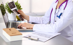 Hands of female medical worker using smartphone Royalty Free Stock Image