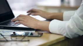 Hands of female office employee typing on laptop, enters survey data, closeup. Stock footage stock photos