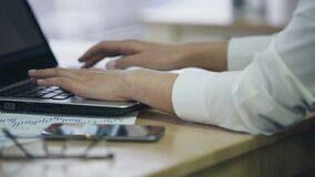 Hands of female office employee typing on laptop, inserting data in e-document. Stock footage stock video