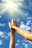 Hands  female   sky   sun Stock Image