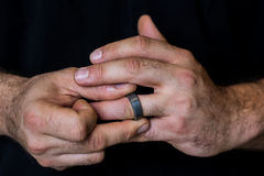 Hands Fidgeting with Ring Stock Photography