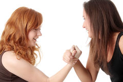 Hands fight. Two womans hands fight, isolated on white background royalty free stock image