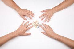 Hands fighting for a wad of euros Royalty Free Stock Image
