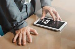 Hands of financial manager on tablet. Businessman planning strat Stock Image
