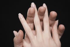 Hands with fingers interlocked stock photo
