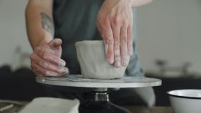 Hands and fingers work on ceramic stock video footage