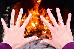 Hands on fire. Hands on the fire in background Royalty Free Stock Image