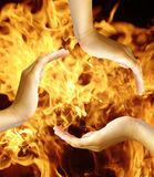 Hands on fire stock photography