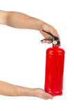 Hands with fire extinguisher Stock Photo