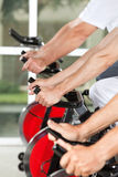 Hands on fitness machines in gym Stock Images
