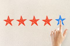 Ranking and exellence concept. Hands with five star rating on light background. Ranking and exellence concept royalty free stock photos