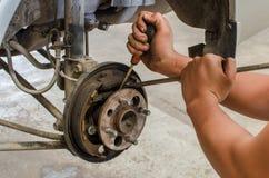 Hands fixing drum brake mechanism car Stock Photo
