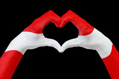 Hands flag of Austria, shape a heart. Concept of country symbol, isolated on black. Royalty Free Stock Images