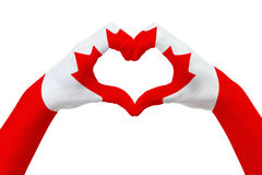 Hands flag of Canada, shape a heart. Concept of country symbol, isolated on white. Royalty Free Stock Photo