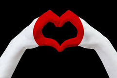 Hands flag of Japan, shape a heart. Concept of country symbol, isolated on black. Royalty Free Stock Photography