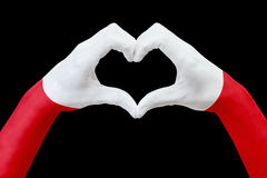 Hands flag of Poland, shape a heart. Concept of country symbol, isolated on black. Royalty Free Stock Image