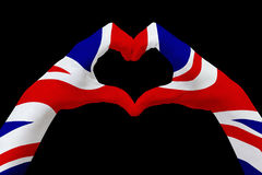 Hands flag of United Kingdom, shape a heart. Concept of country symbol, isolated on black. Royalty Free Stock Photo